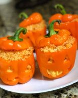 Jack O' Lantern Macaroni and Cheese Stuffed Peppers